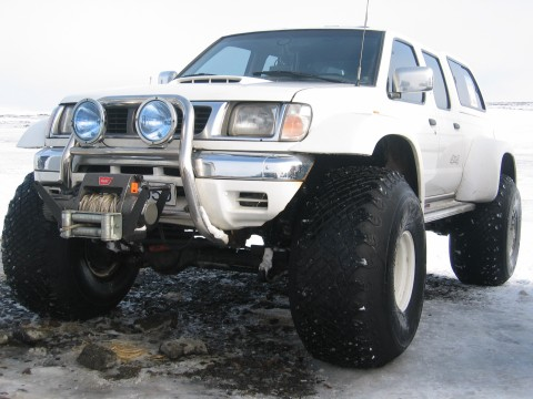 Nissan pickup truck on 44 inch tires